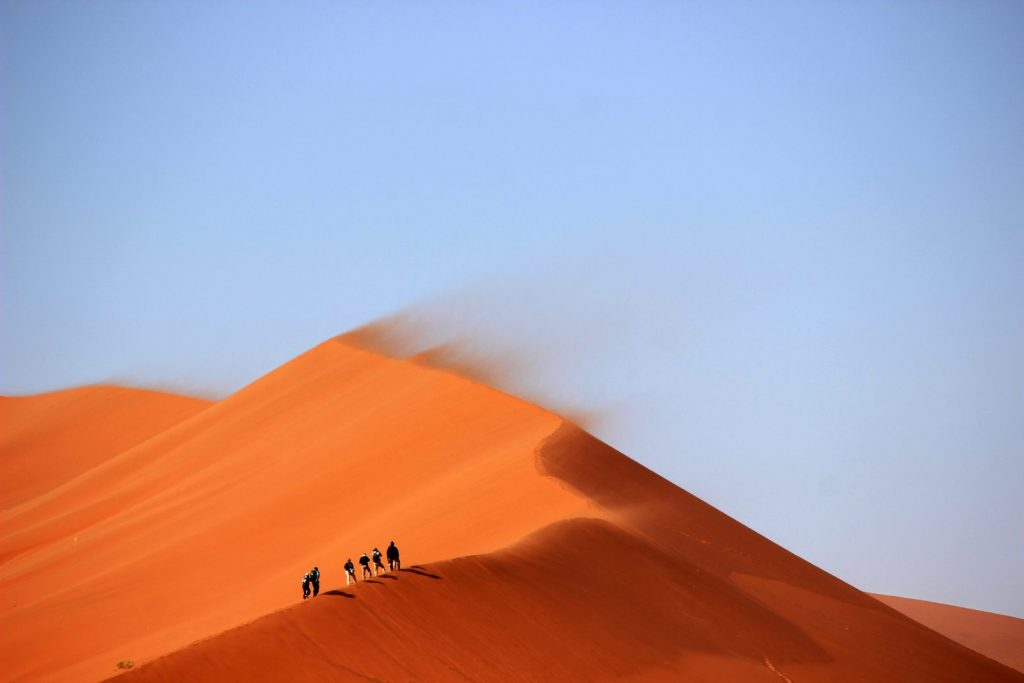 men walking in desert